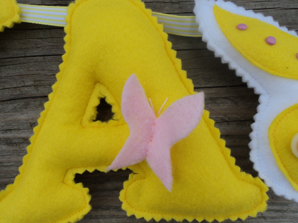 felt letter yellow pink butterfly