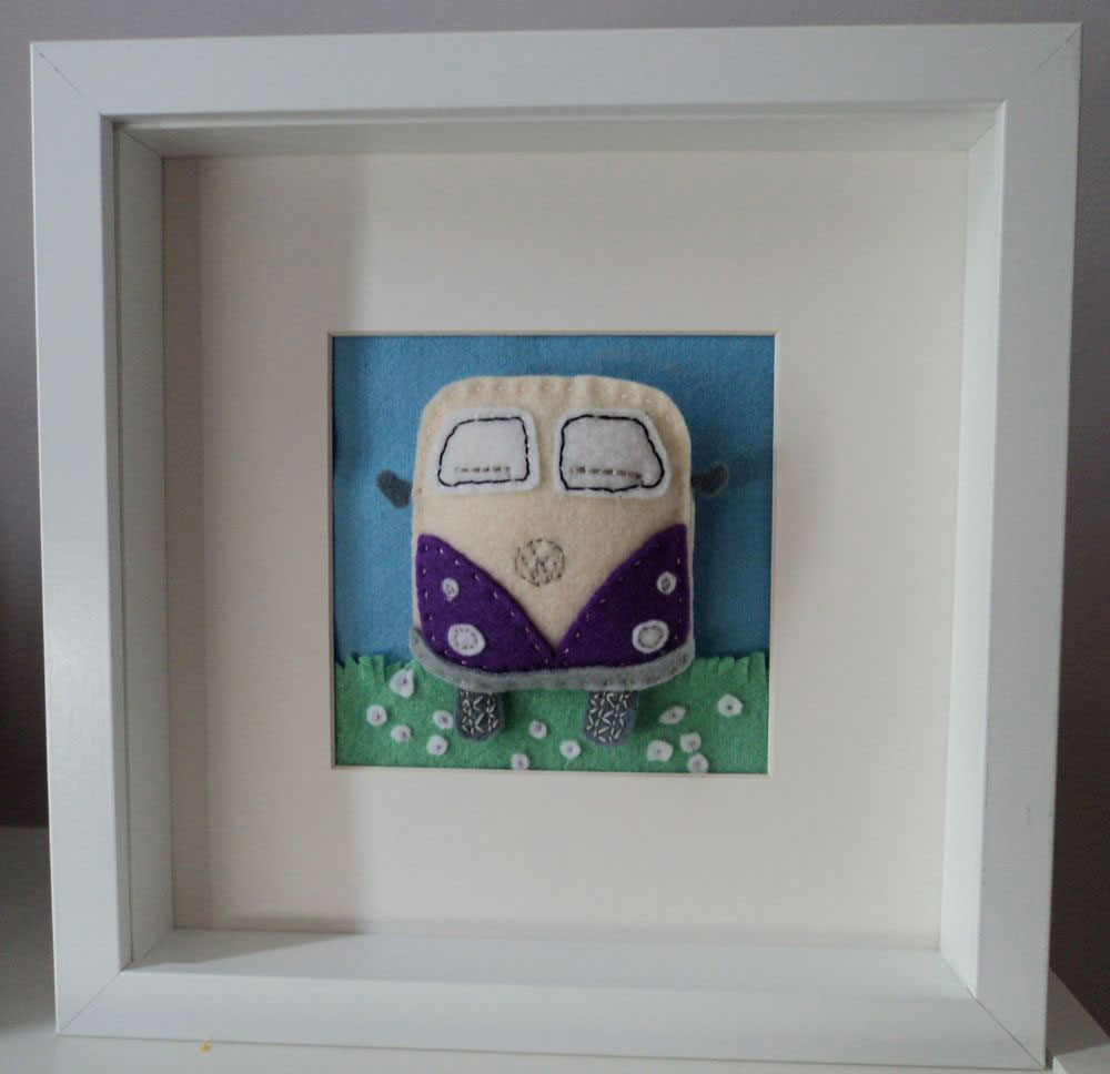 Custom Order — this does have a personalised licence plate but as it's a gift I haven't photographed it with the licence plate attached. Hand cut felt VW Camper Van which is slightly padded, flower lined grass and in a 10 inch squared box frame, mounted so that the picture is 4½ inches square. Each part is hand cut and hand stitched by me and is very labour intensive — because of this no two frames will be the same. This is just an example of the pictures I can do. Prices for these start at £20 depending on the size of the picture and the level of detail required. This on was priced at £20.