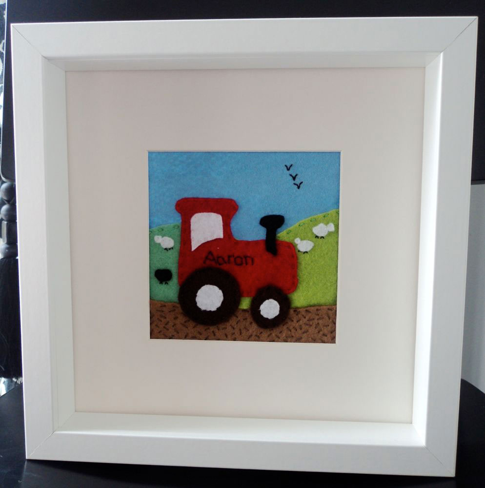 Felt Box Frame — Mounted. Hand cut felt tractor personalised with the name Aaron a 10 inch squared box frame, mounted so that the picture is 4½ inches square. Detail is hand cut and hand stitched by me and is very labour intensive. This is just an example of the pictures I can do. Prices for these start at £20 depending on the size of the picture and the level of detail required.