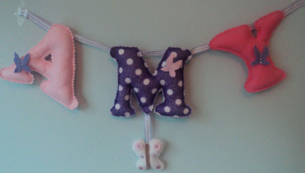 Large letters Name Banner — with a small butterfly hanging. £12 for up to four letters. £2 for each additional letter. Each of the letters are 4½ inches tall — the length of the banner will depend on the letters used (as some letters are wider than others) and the number of letters required. These can be done in any combination of colours.