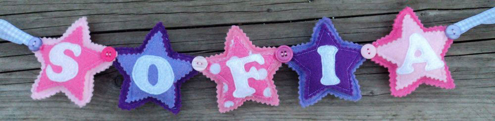 Star Name Banner in Pinks / Purple. £12 for up to four letters, each additional letter is £2. This one is priced at £14. Each shape is 3½ inches tall and usually the same width. These can be done in any combination of colours.