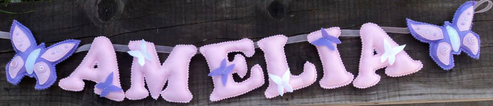 Butterfly Name Banner- in pink, lilac and white. £16 for up to three letters (this includes the butterfly's at either end, so the two butterfly's plus three letters). £2 for each additional letter. This one is priced at £22. Each of the letters are 4½ inches tall — the length of the banner will depend on the letters used (as some letters are wider than others) and the number of letters required. These can be done in any combination of colours.