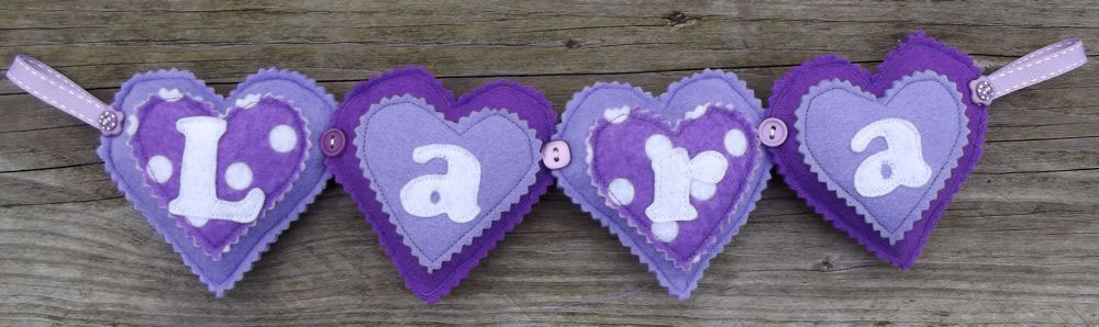 Heart Name Banner in Purple £12 for up to four letters, each additional letter is £2. This one is priced at £12. Each shape is 3½ inches tall and usually the same width. These can be done in any combination of colours, Pink is the most popular colour with this item.